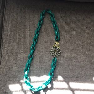 Turquoise necklace with frog embellishment.